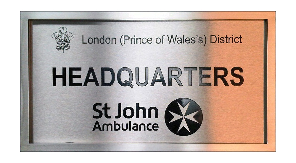 St John Ambulance company sign in stainless steel or polished brass