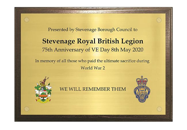 Brass commemorative VE Day plaques engraved with wooden backing