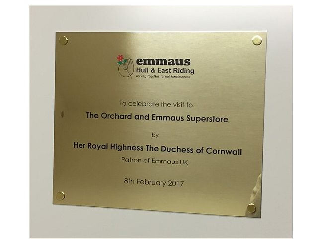 Brass commemorative plaques engraved for Duchess of Cornwall in frame