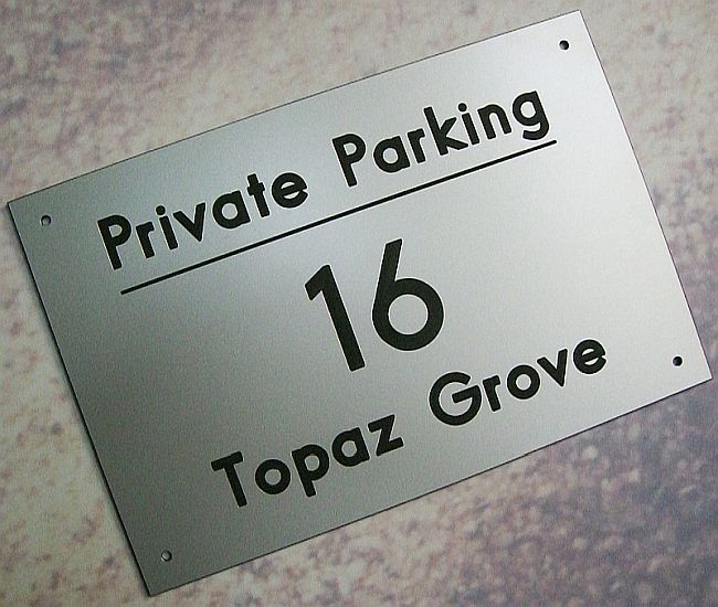 Plastic safety signs and plaques engraved