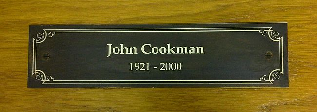 Brass antiqued memorial plaque engraving with white detail